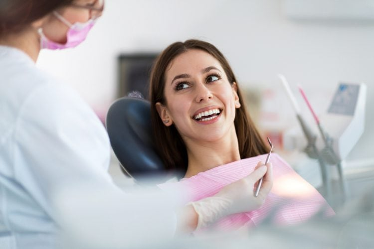 Happy women looking at dentist smiling